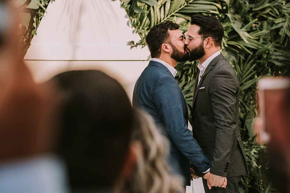 gay couple kissing on their wedding day