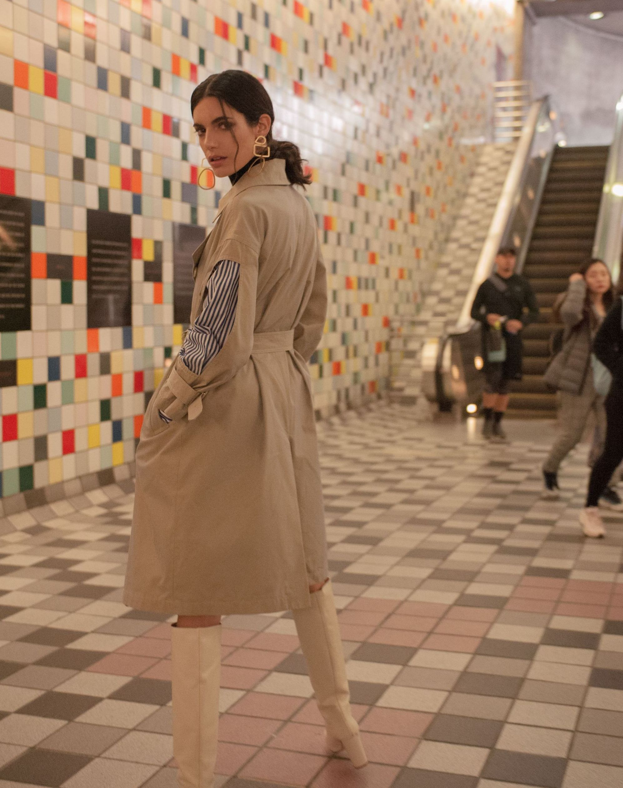 Model wearing the Hildy Trench Coat by J.ING women's clothing