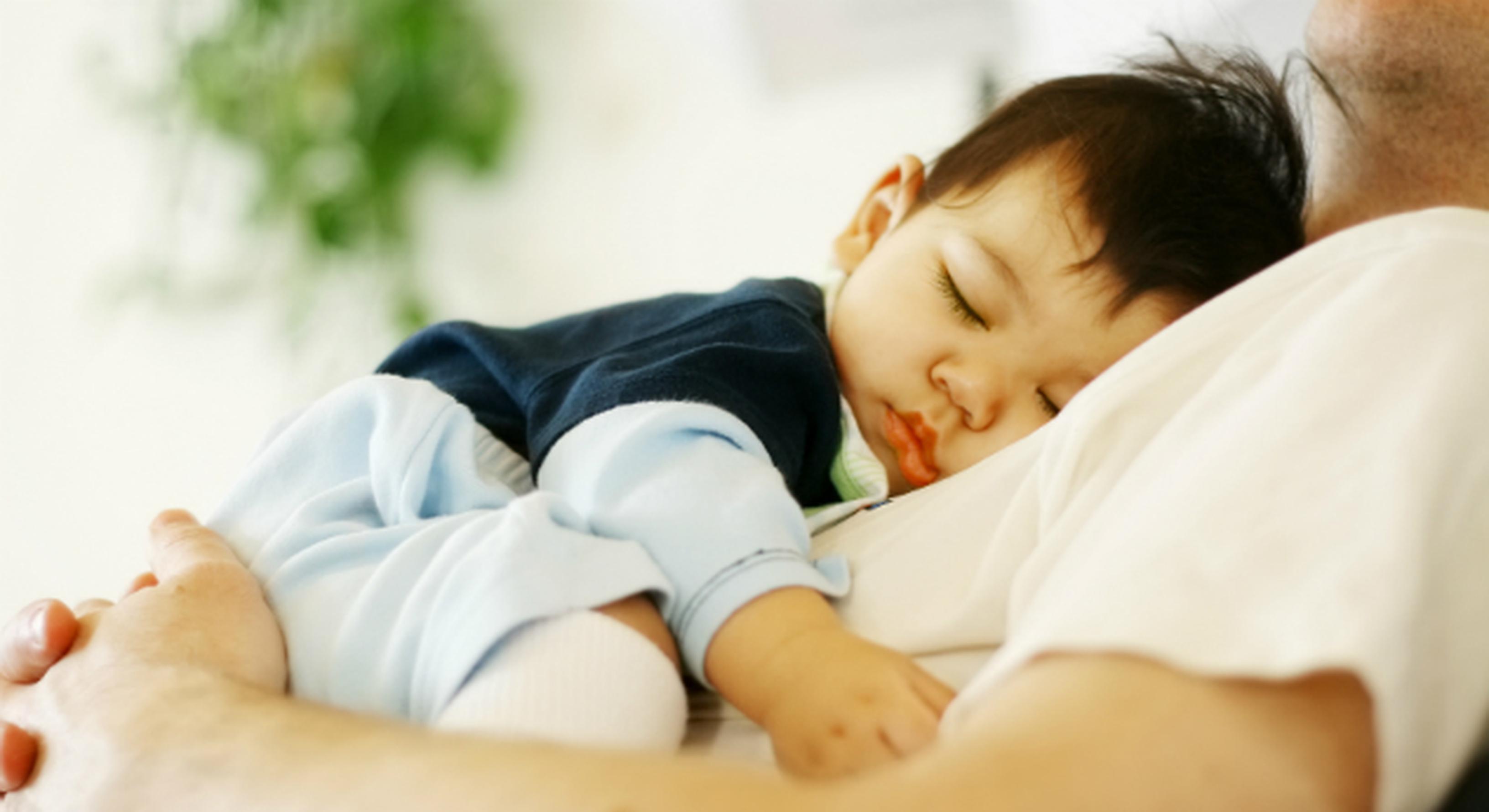 baby boy asleep on dad's chest