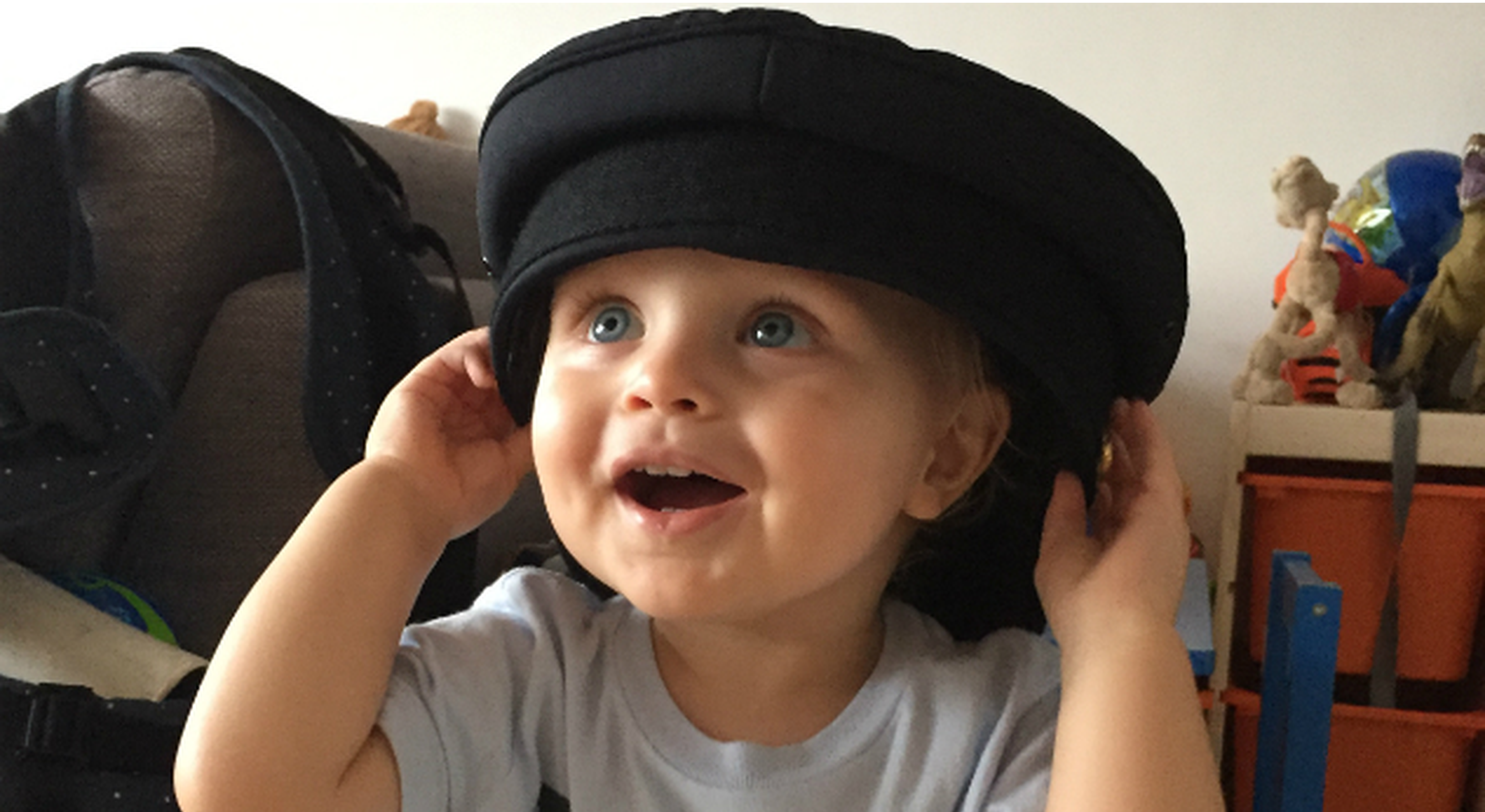Toddler wears pilot's hat