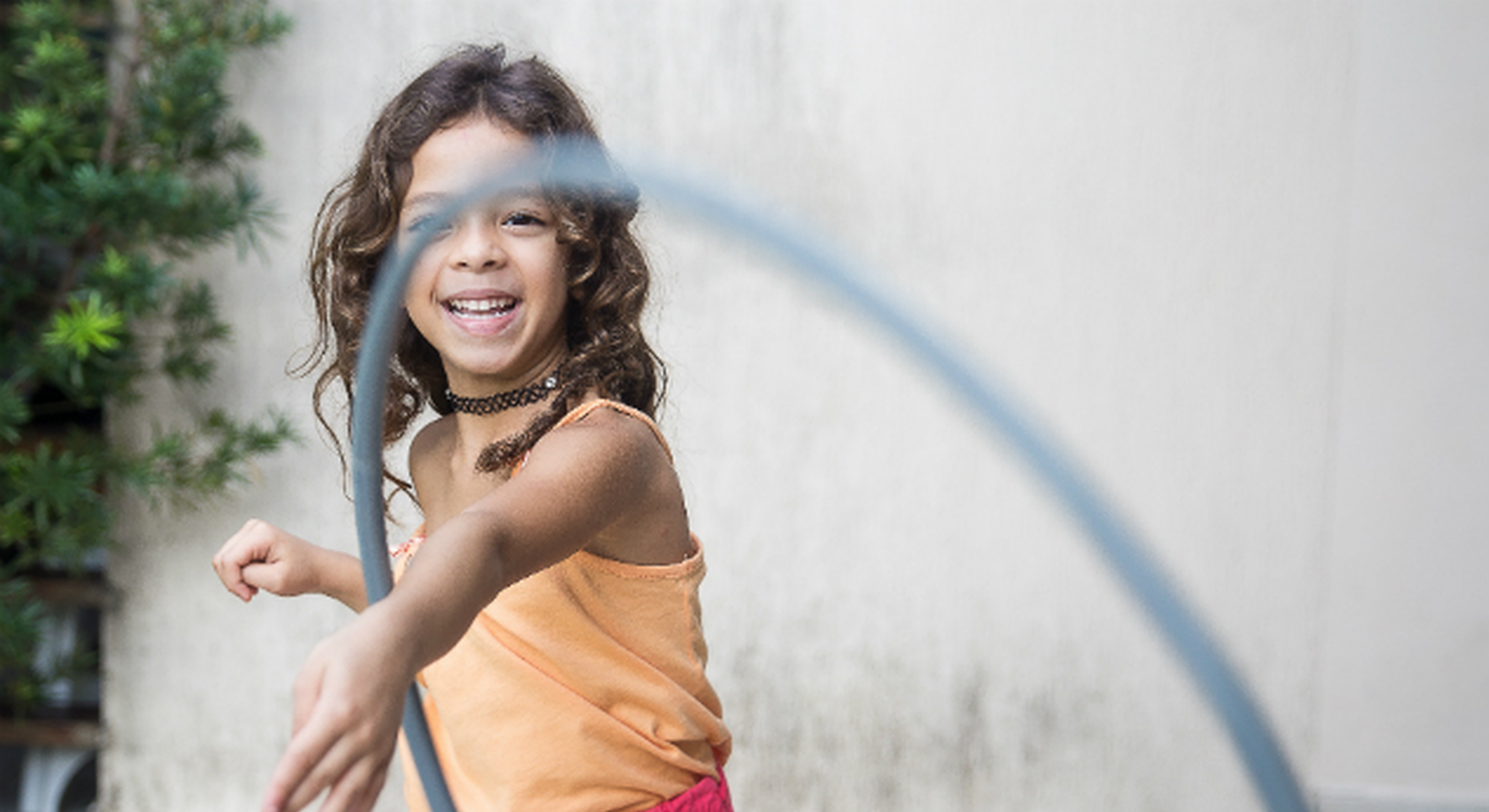 Girl playing with a hula hoop