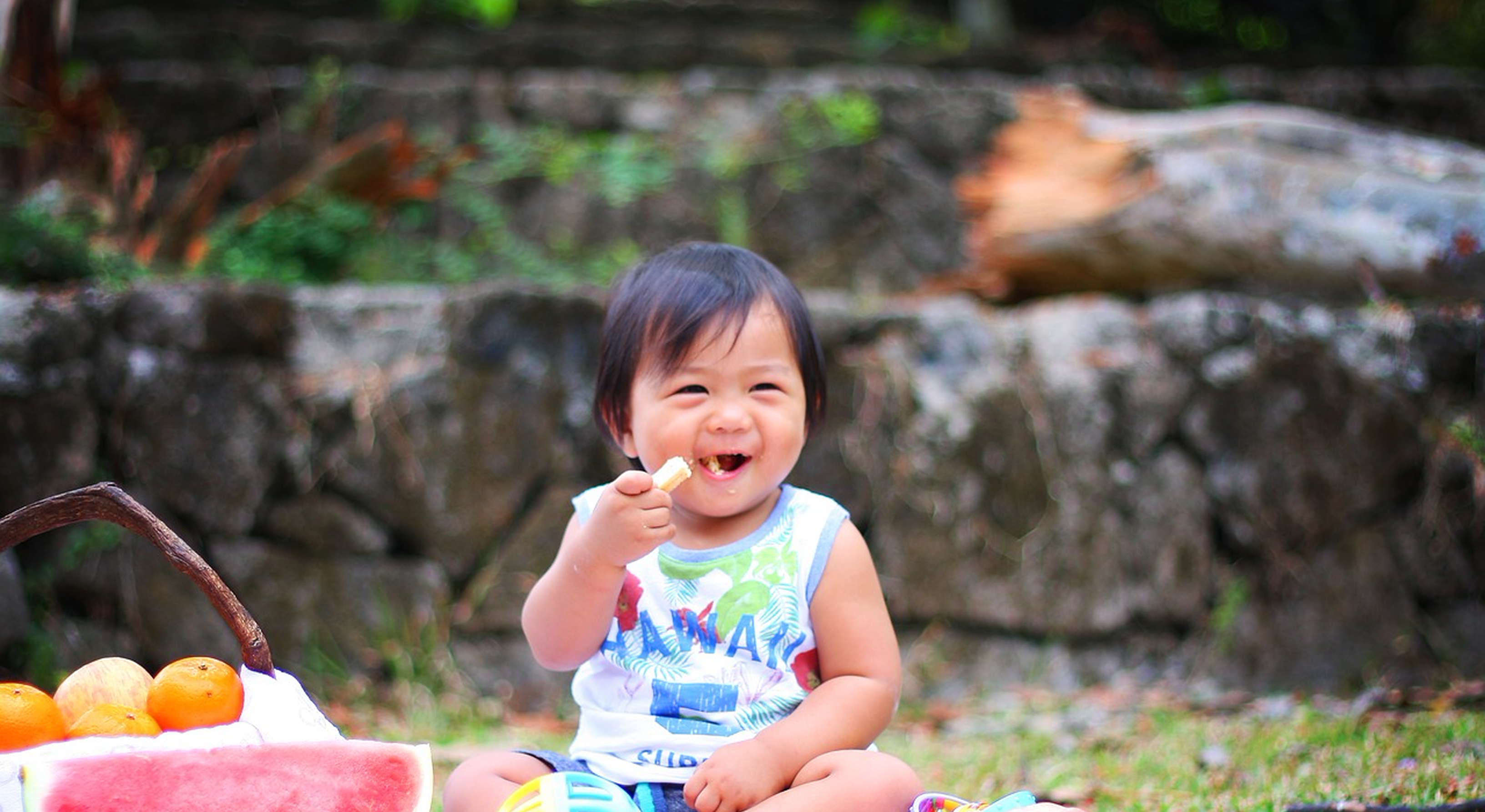 Toddler eating snacks outdoors
