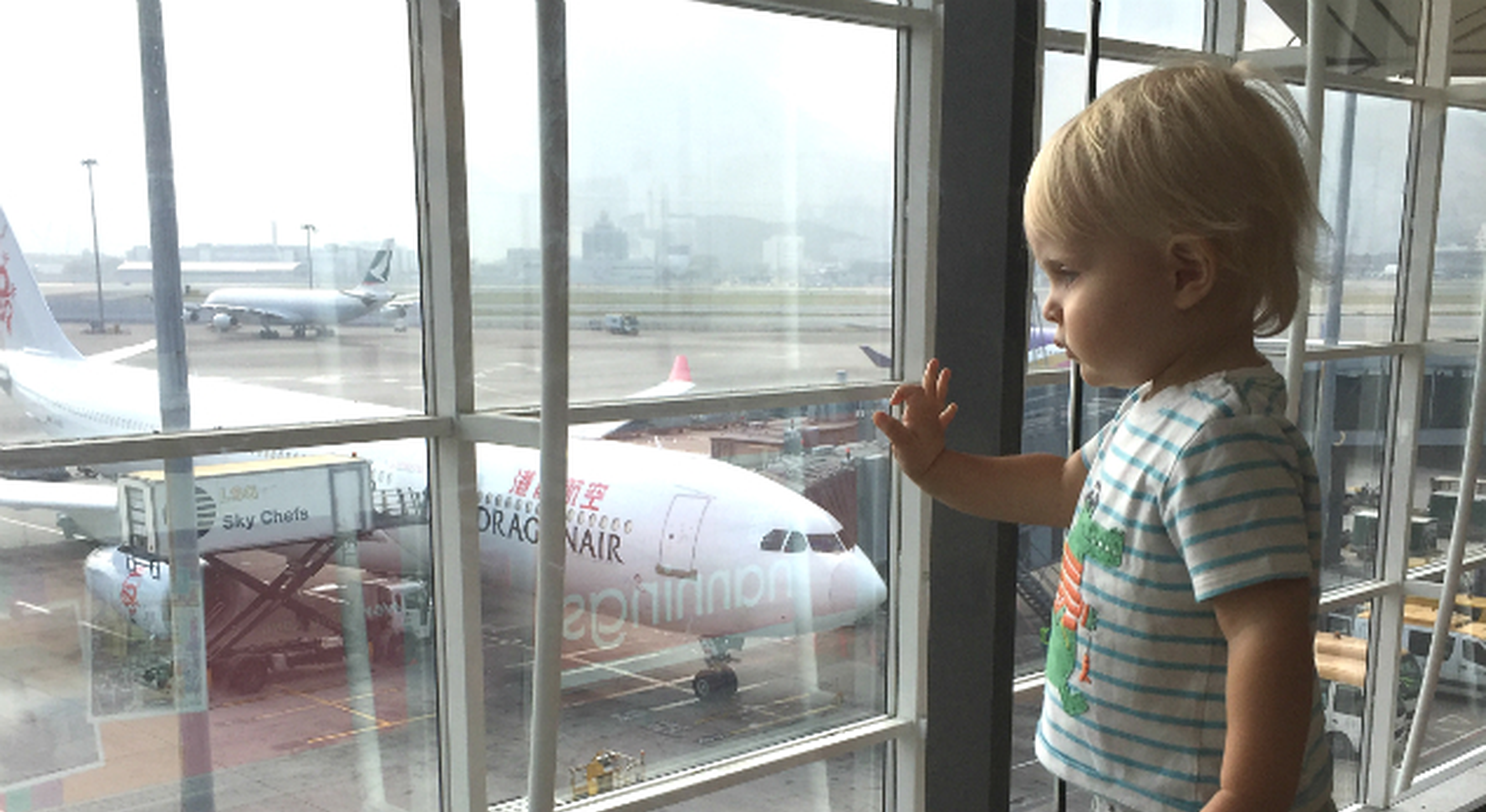 Boy watching planes at an airport