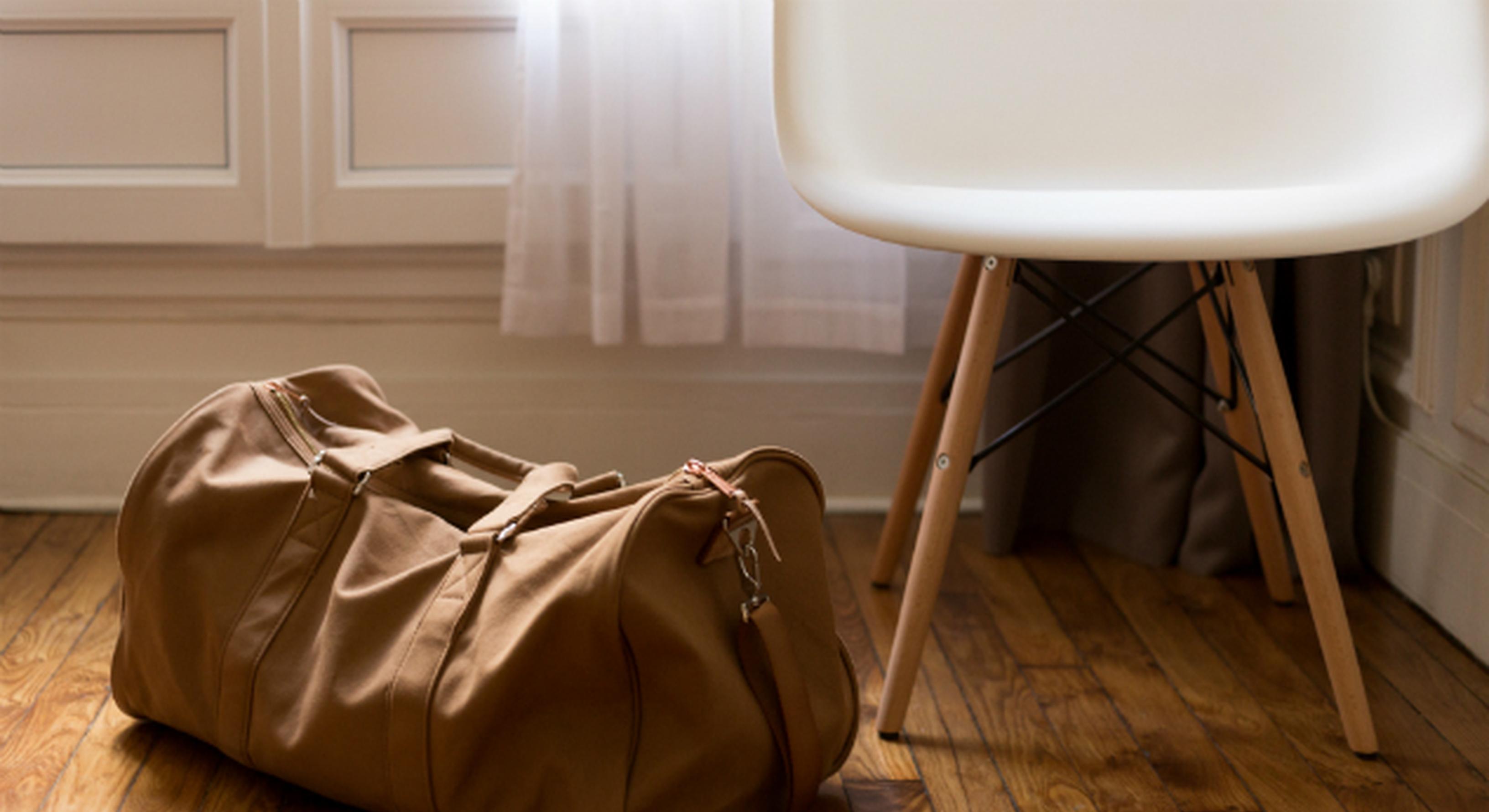 Man's bag sat on the floor