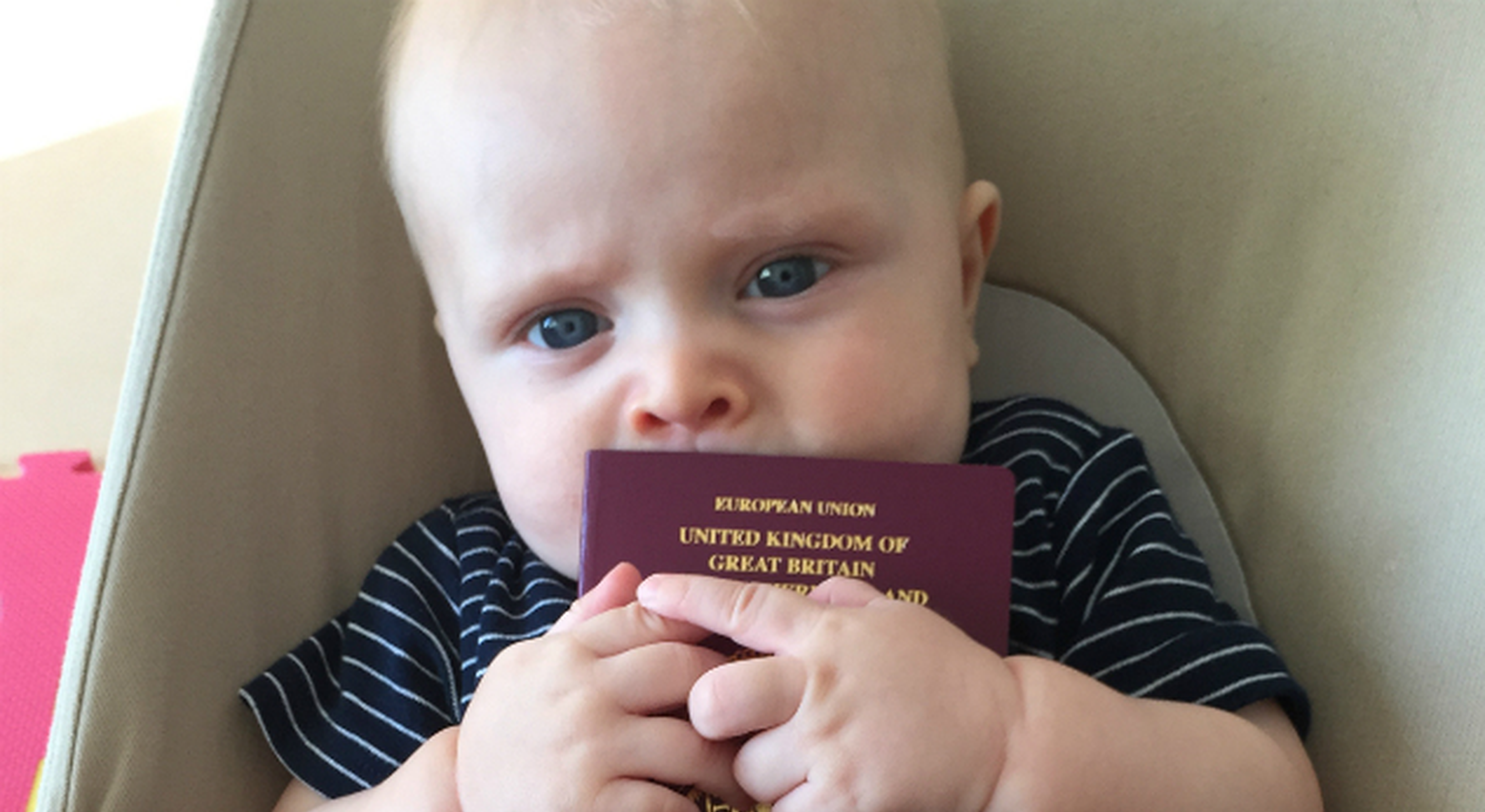 Baby boy holding British passport
