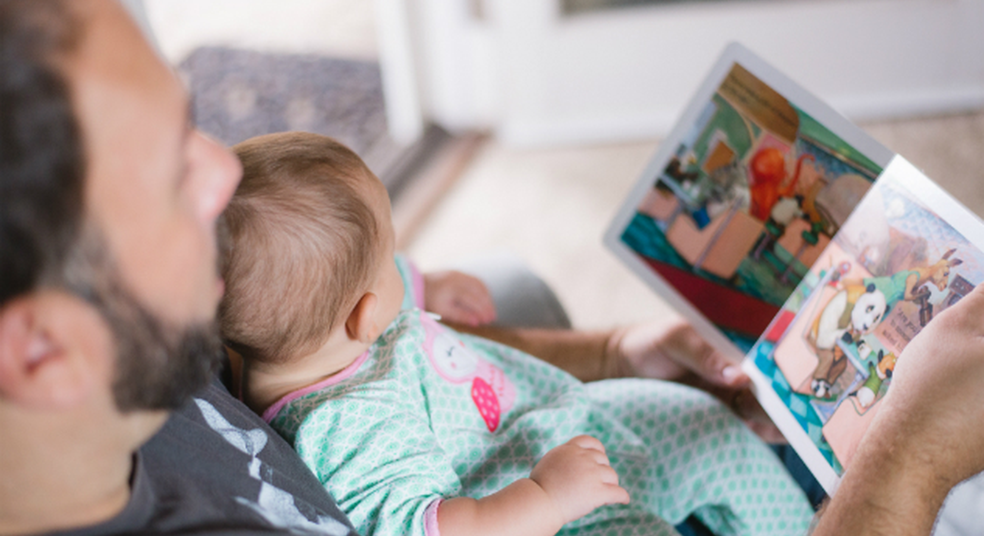 Dad reading to his daughter