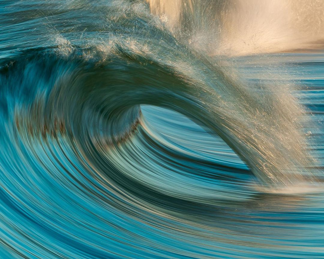 teal wave in ocean