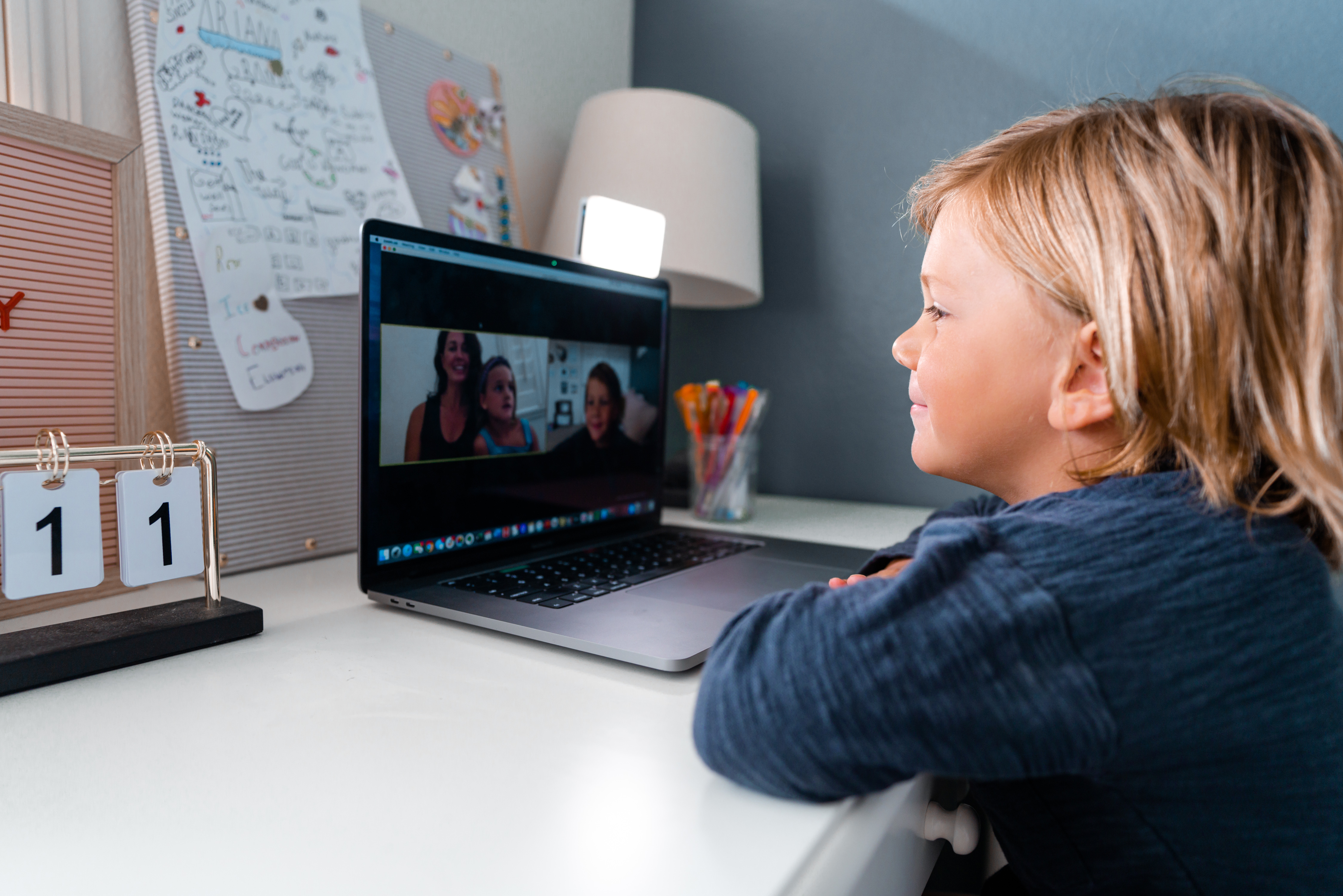 child attending school class on zoom video meeting