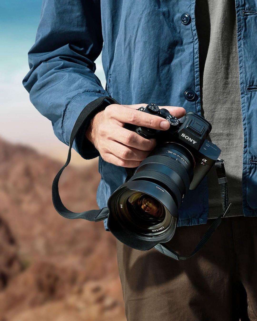 man holding sony dslr camera