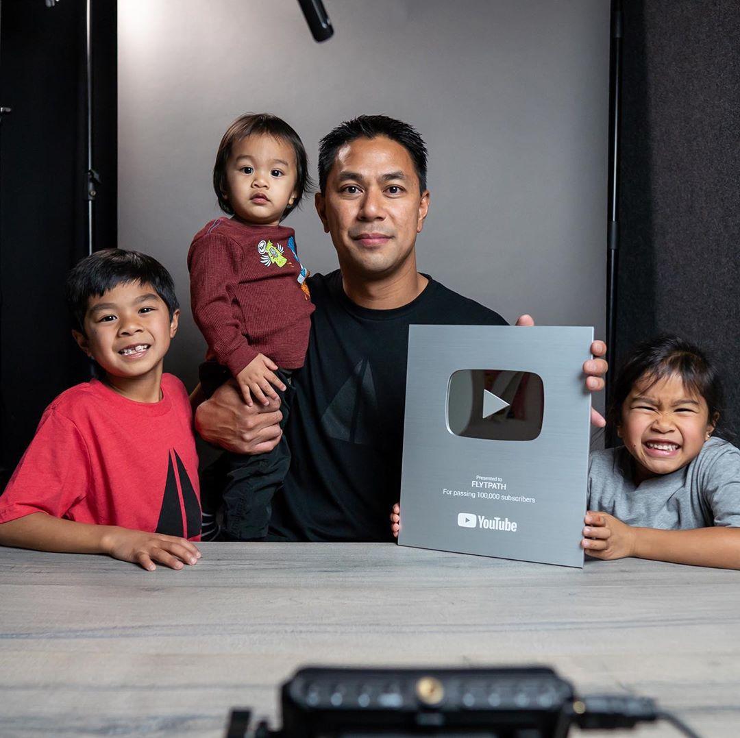 Aldryn Estacio and family holding youtube plaque