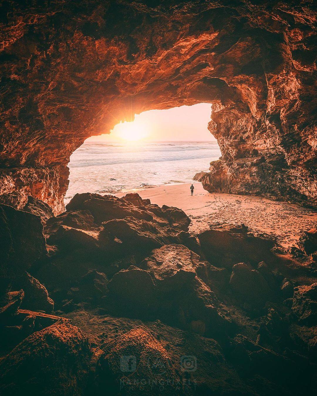 view of ocean through cave