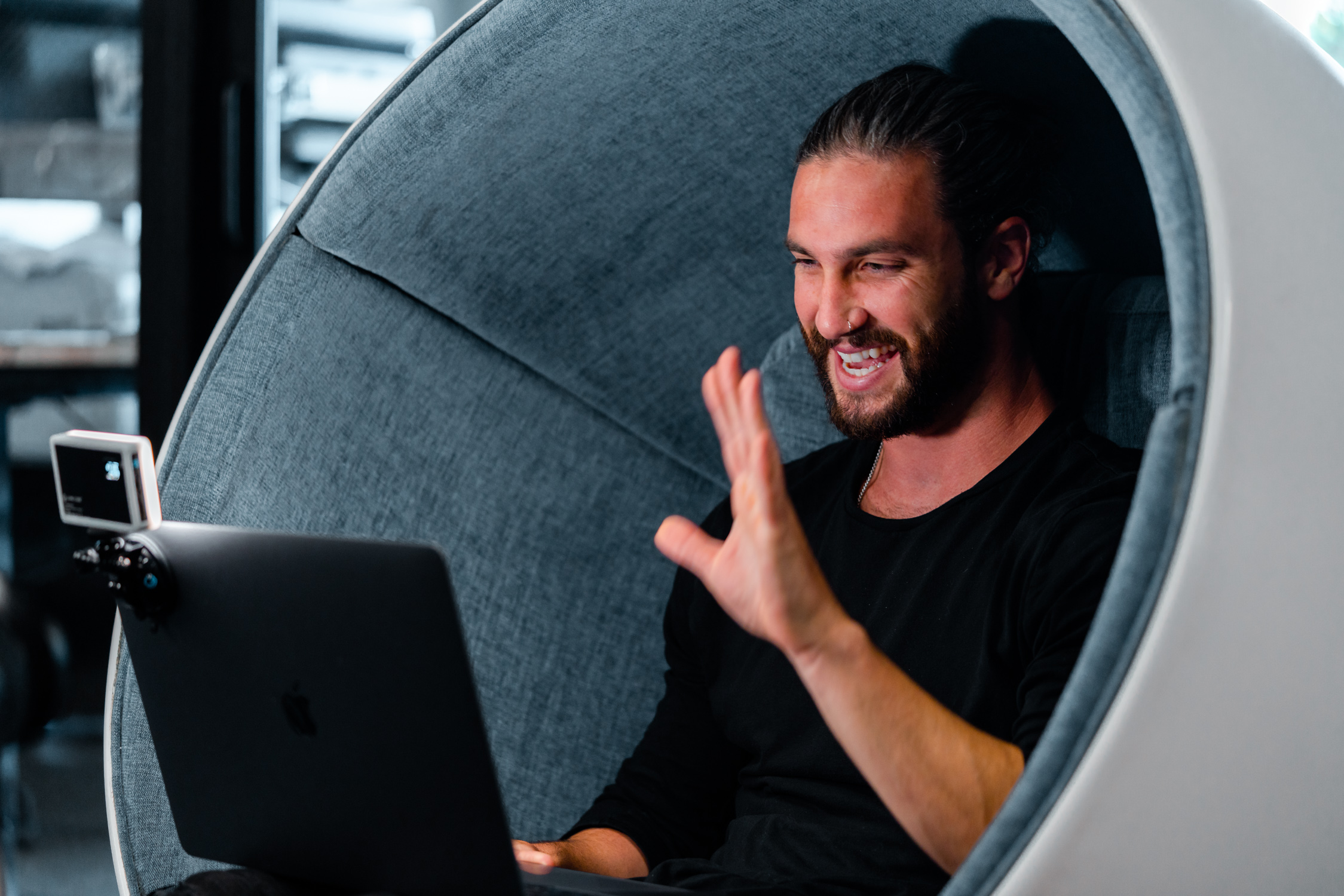 man sitting in chair on work meeting using the video conferencing kit