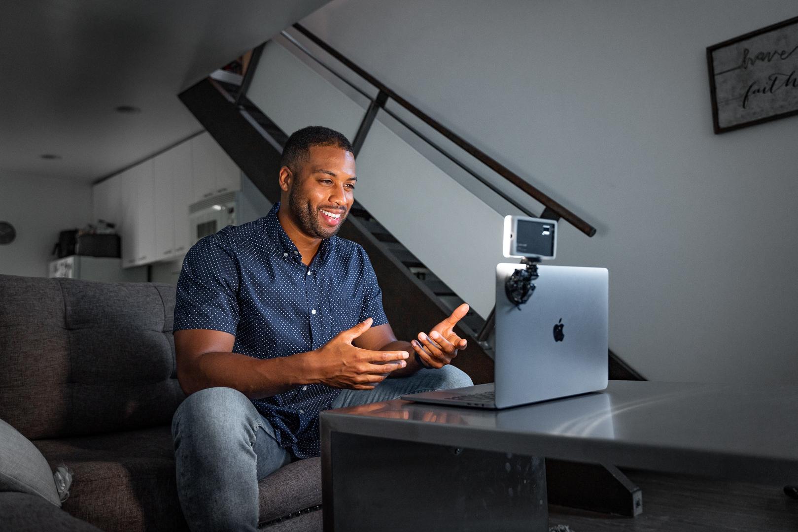 man on work zoom meeting in his living room