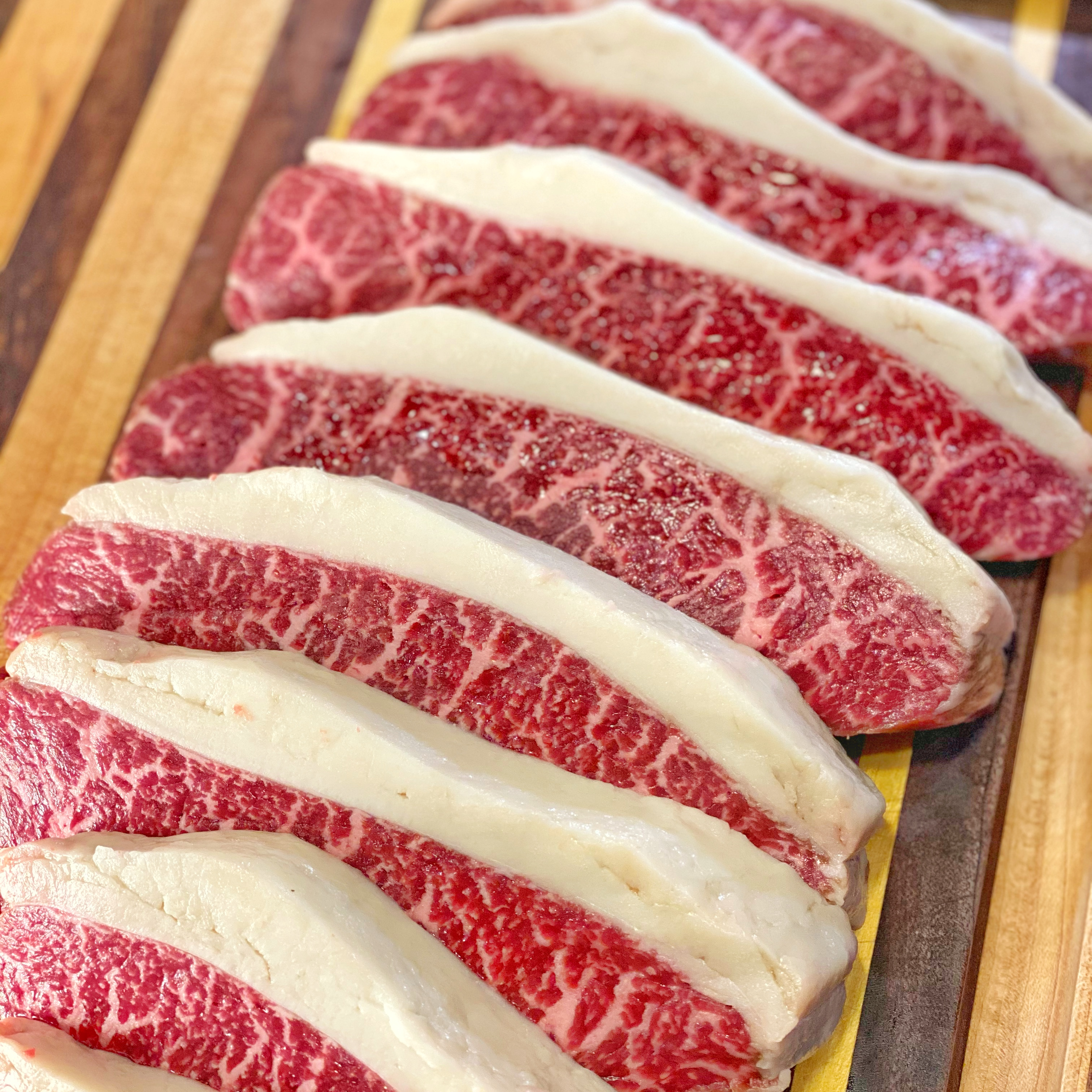 slices of meat on cutting board