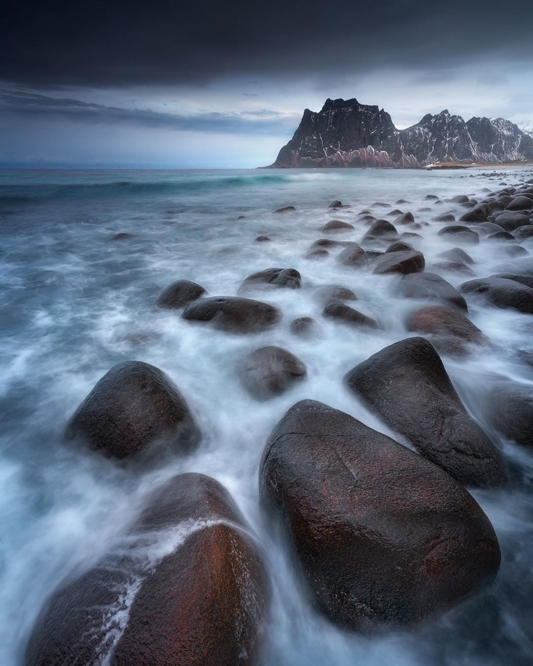 norwegian ocean water crashing into rocks