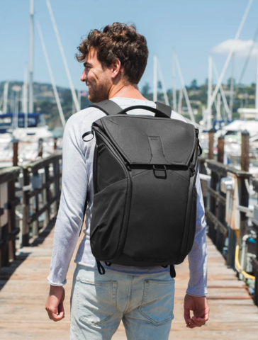 man walking with backpack on