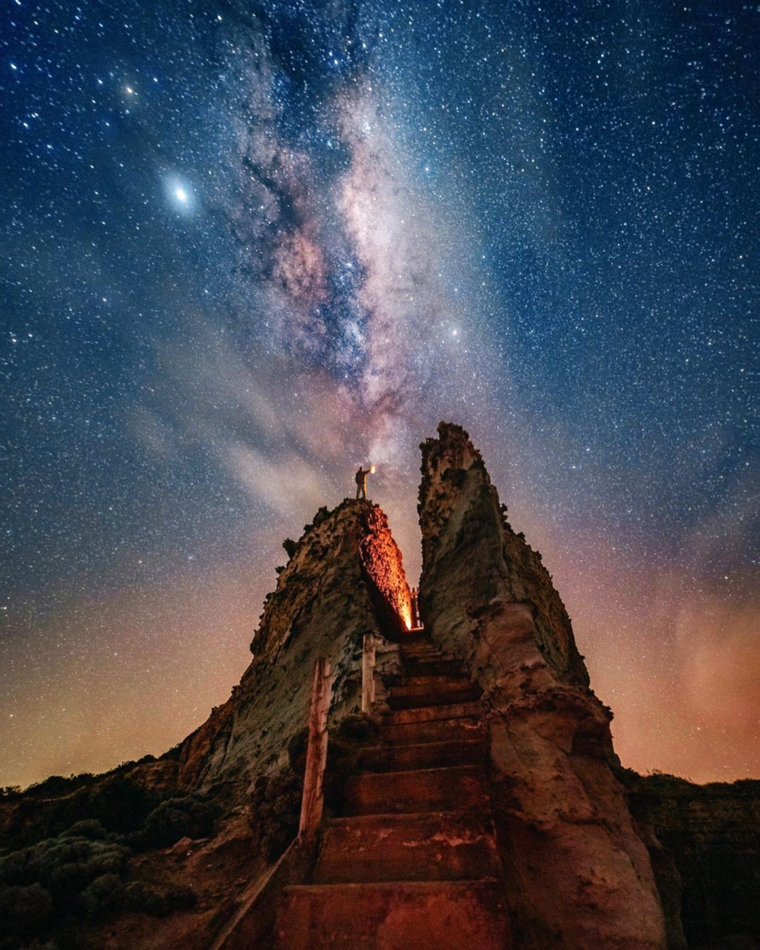 rock stairs leading up to view of Milky way galaxy