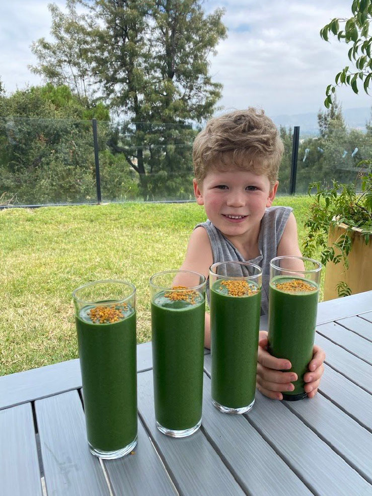 boy enjoying an anti inflammatory smoothie