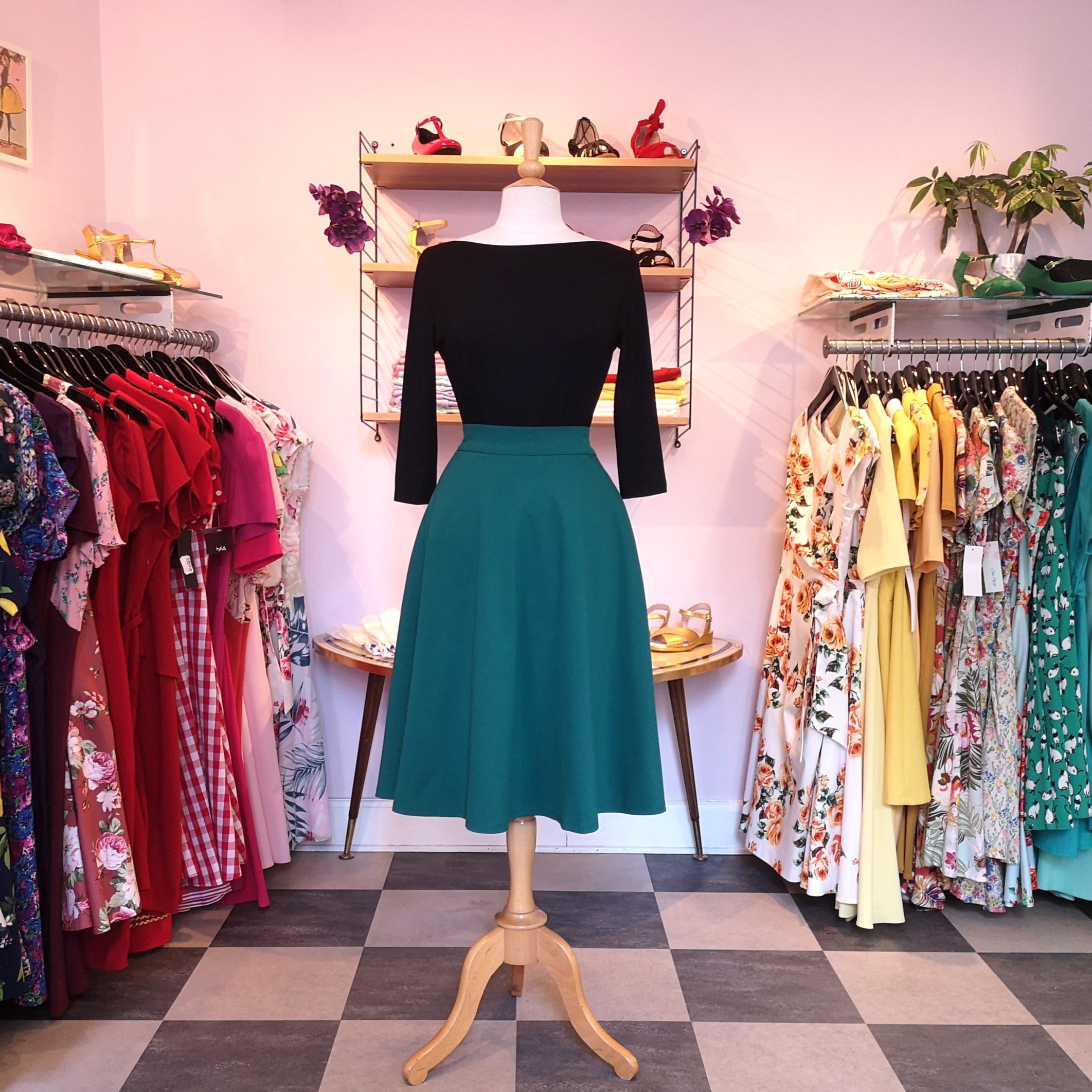 1950s style top in black with green 1950s style skirt