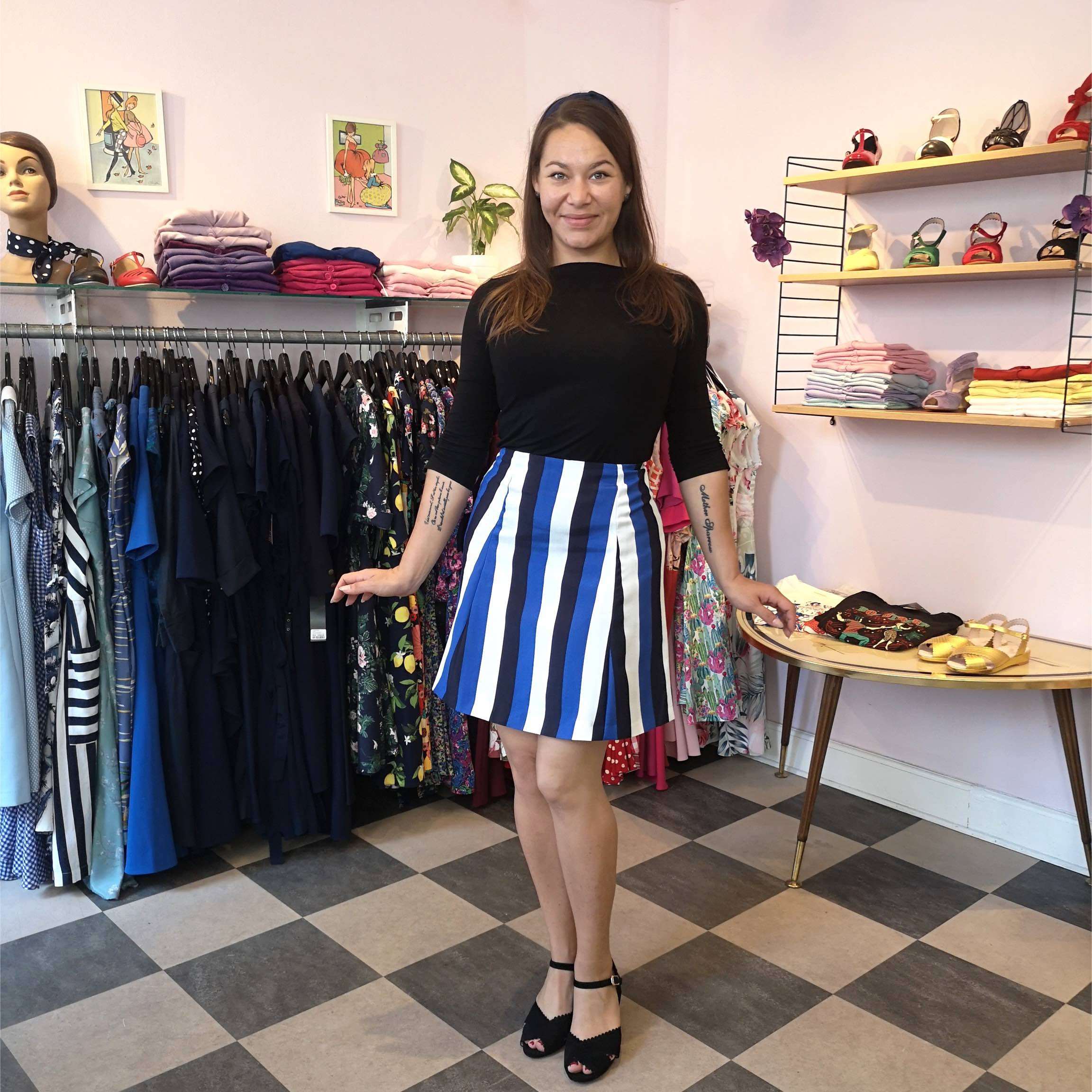 1960s inspired outfit of black classic top and striped 1960s skirt
