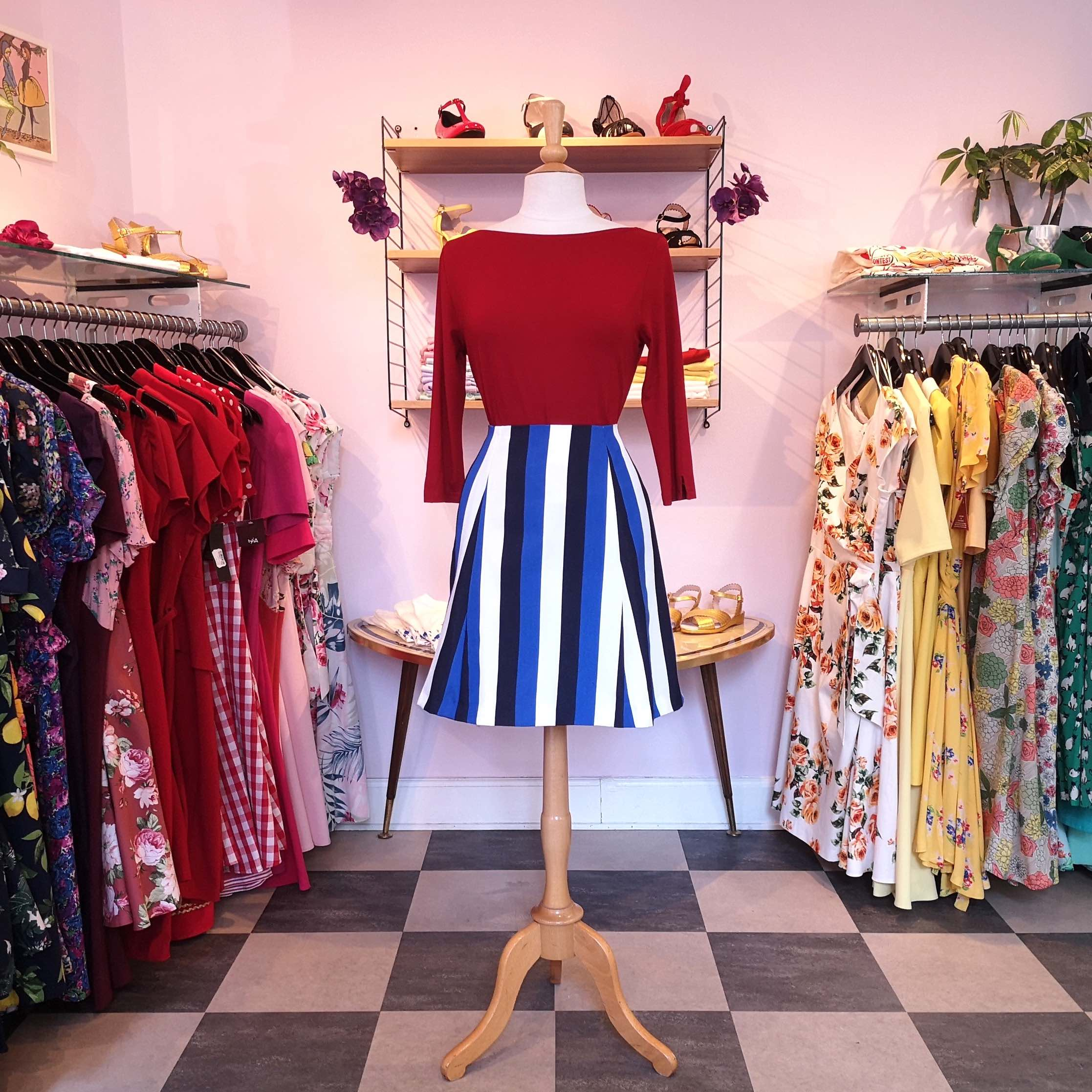 1960s style set of red top as well as striped mini skirt