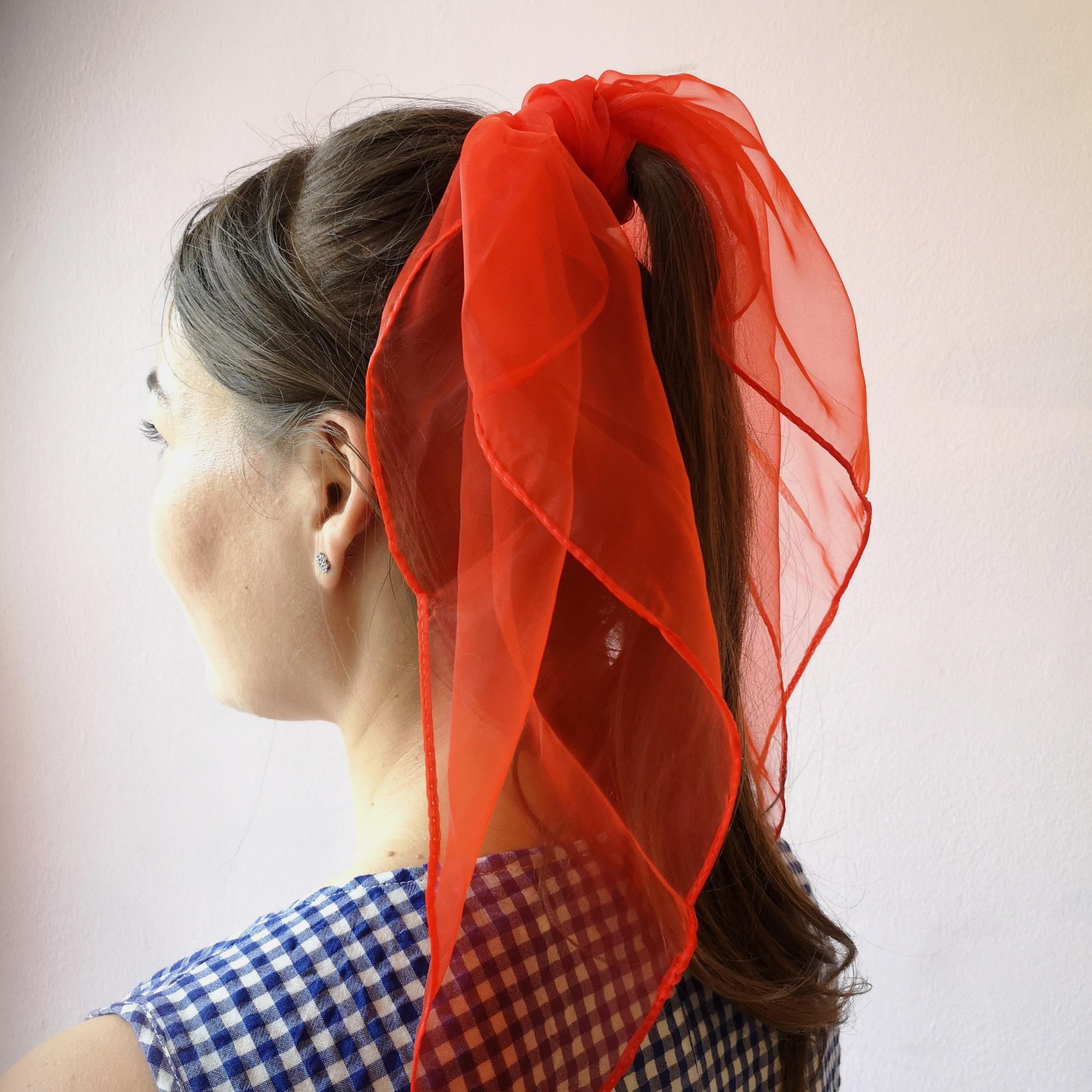 1950s pinup hairstyle with high ponytail made with chiffon scarf