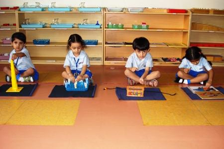 Montessori Observing Working Children