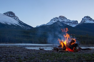 camp fire with an incredible mountain view