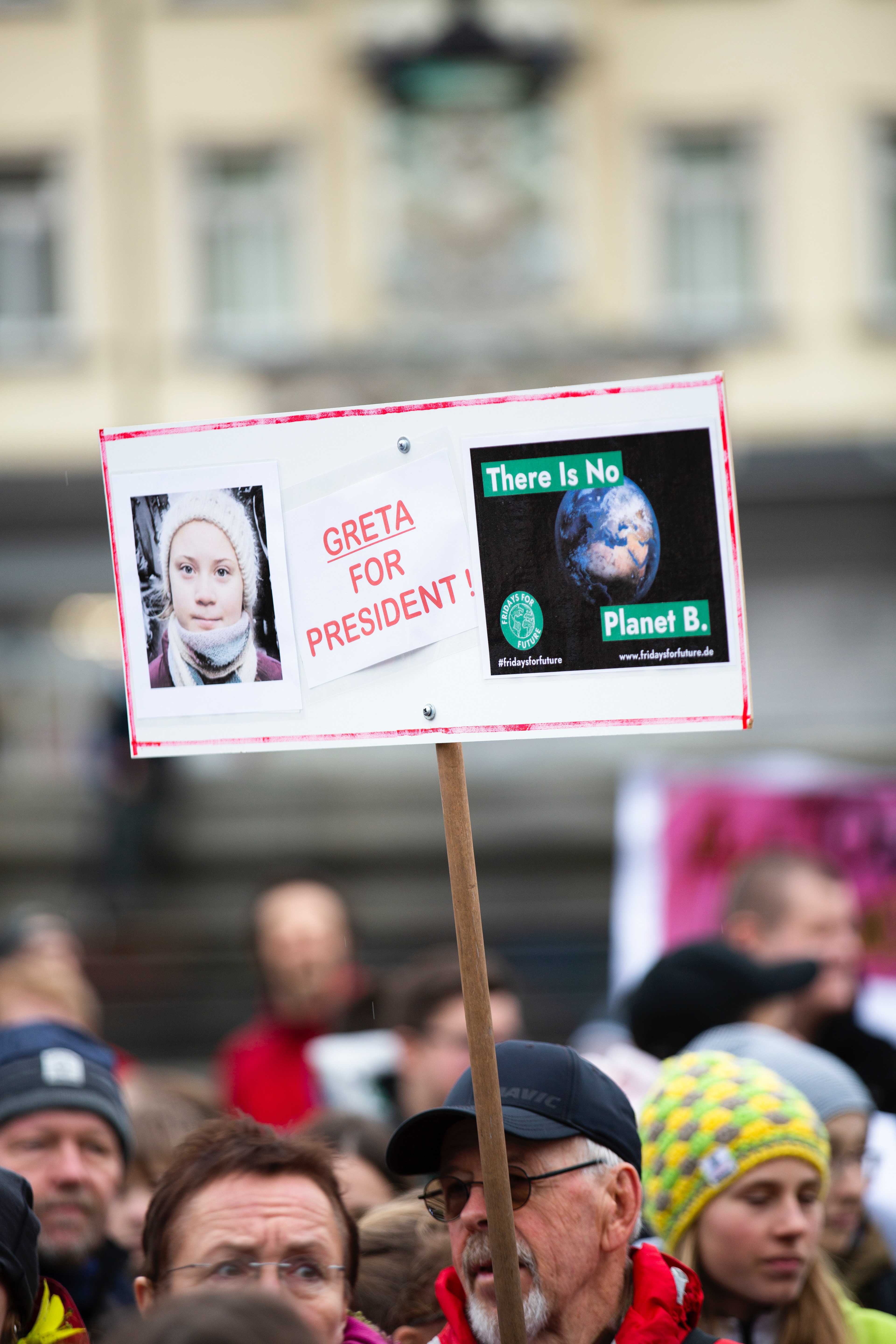 Protest sign with Greta Thunberg's face