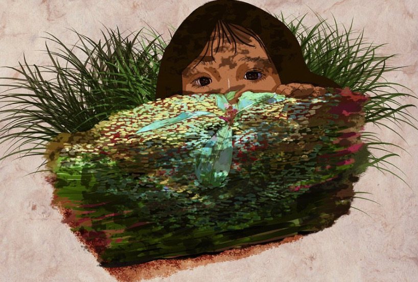 Woman peaking over a mossy log