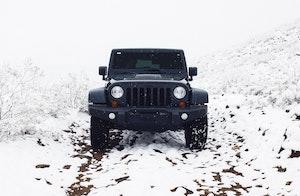 black jeep wrangler in the snow