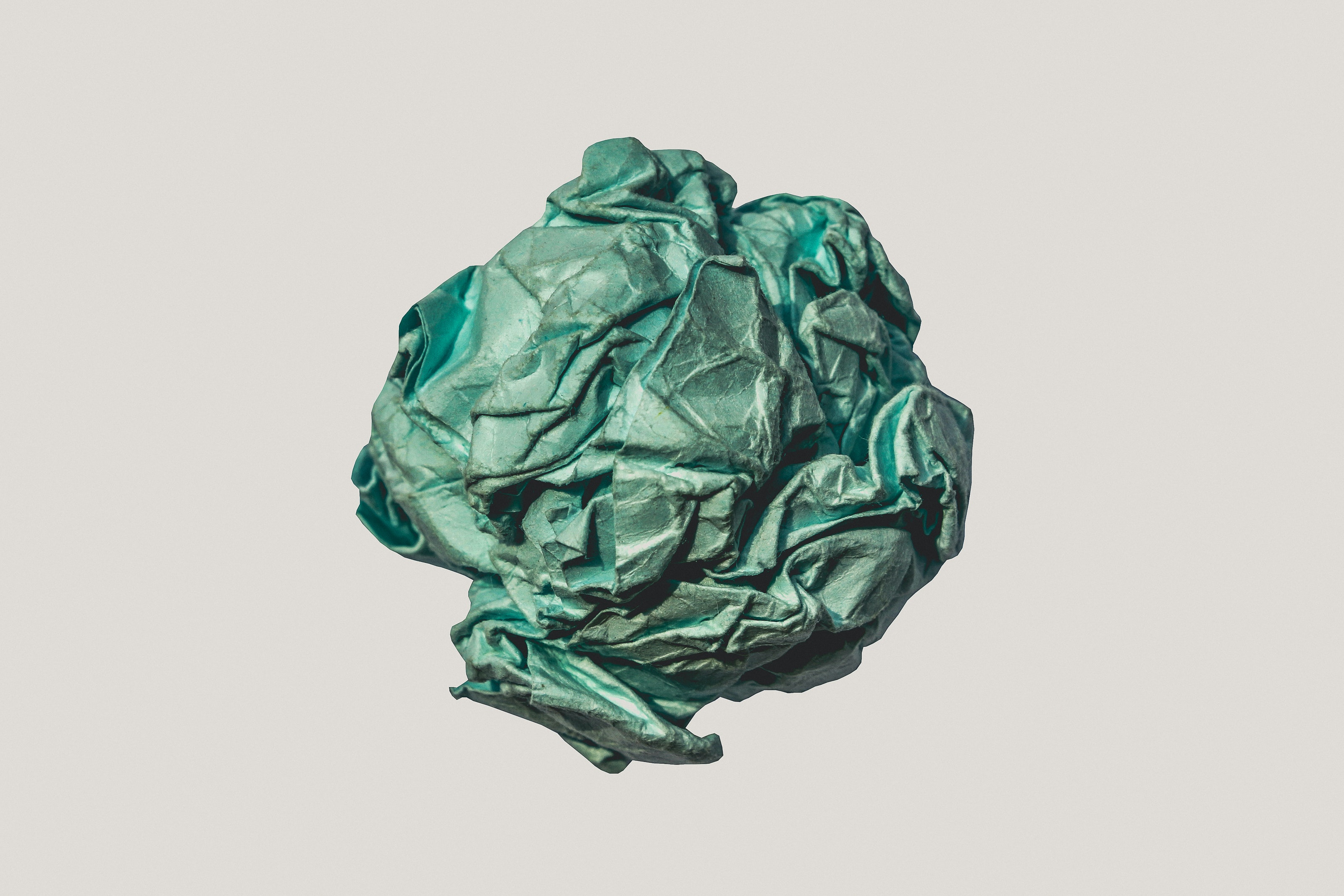 Crumpled green ball of paper