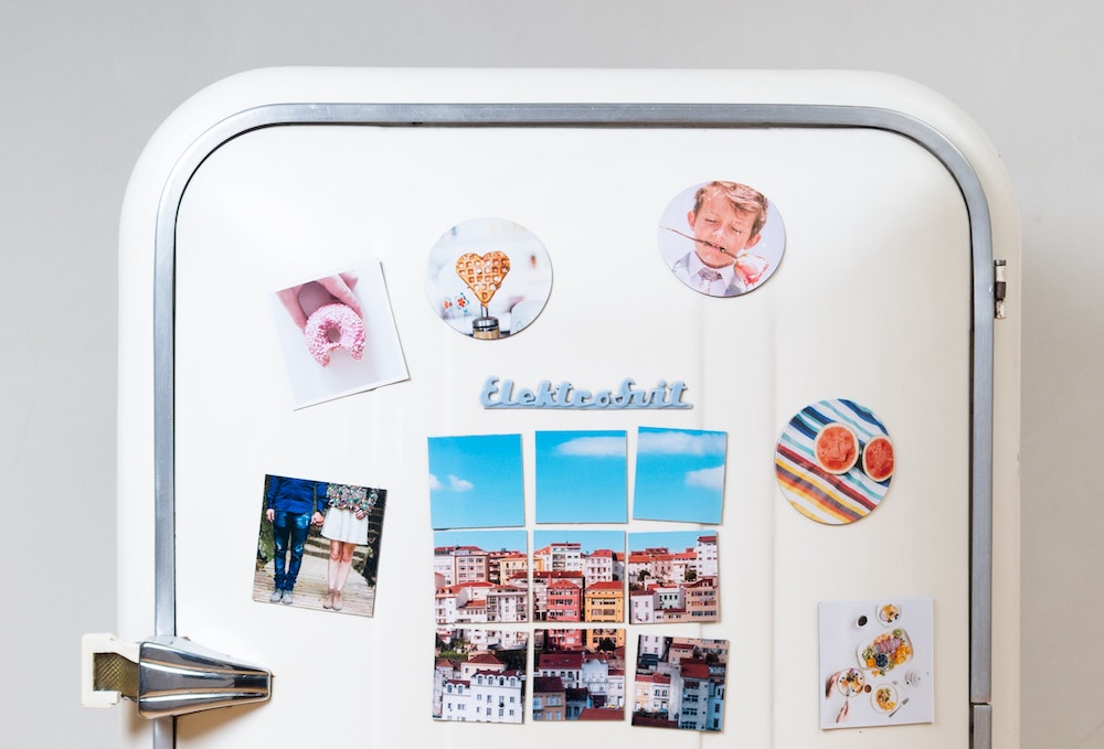 refrigerator with colorful photos
