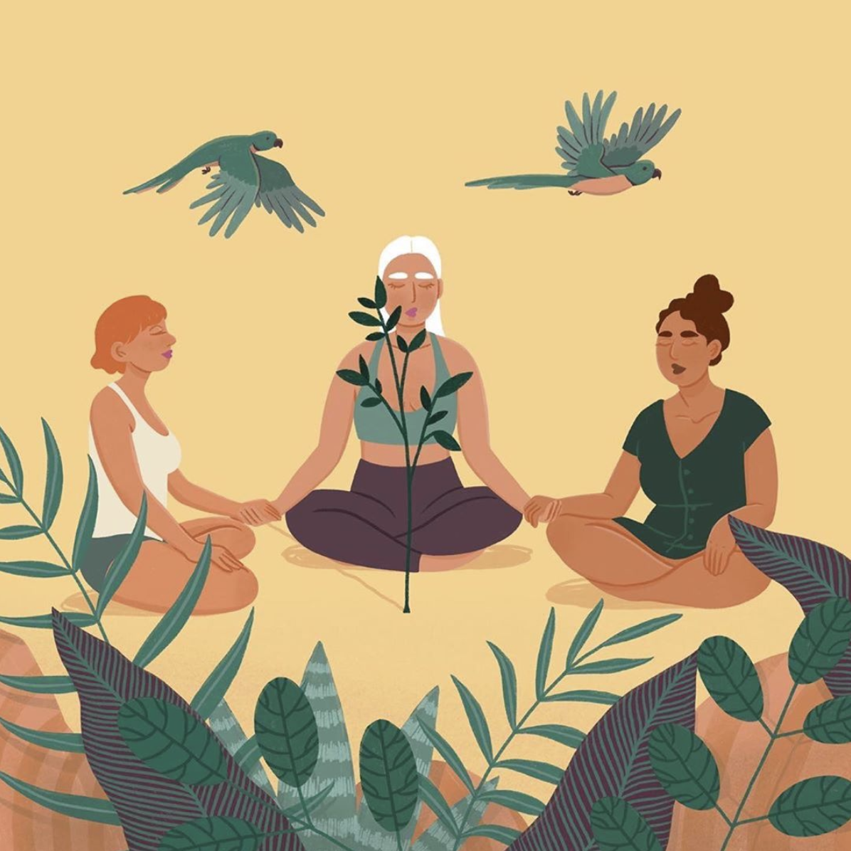 women sitting surrounded by plants
