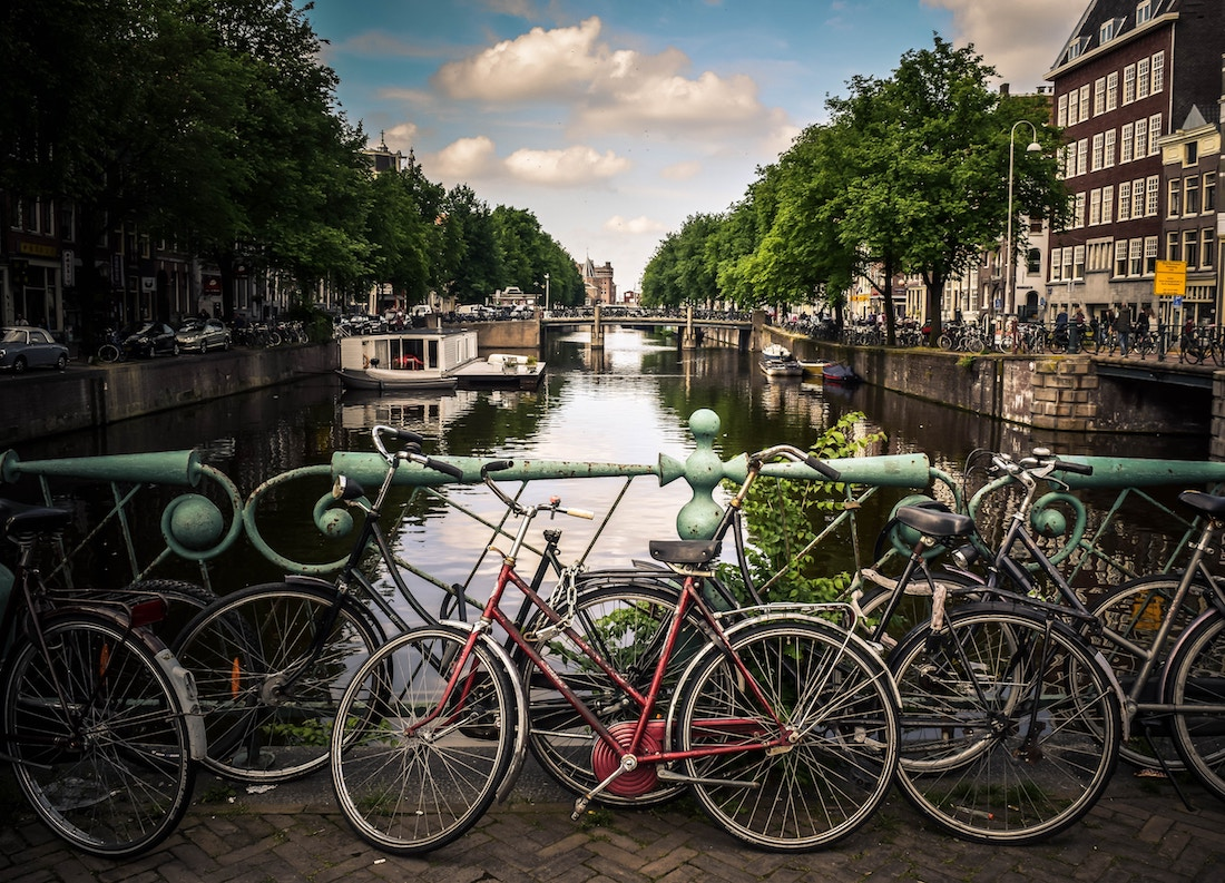 An Amsterdam canal with bikes in summer