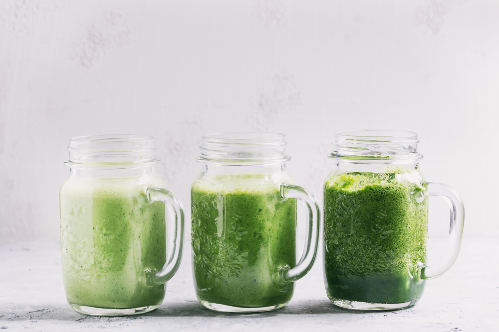 three green juices with varying levels of pulp