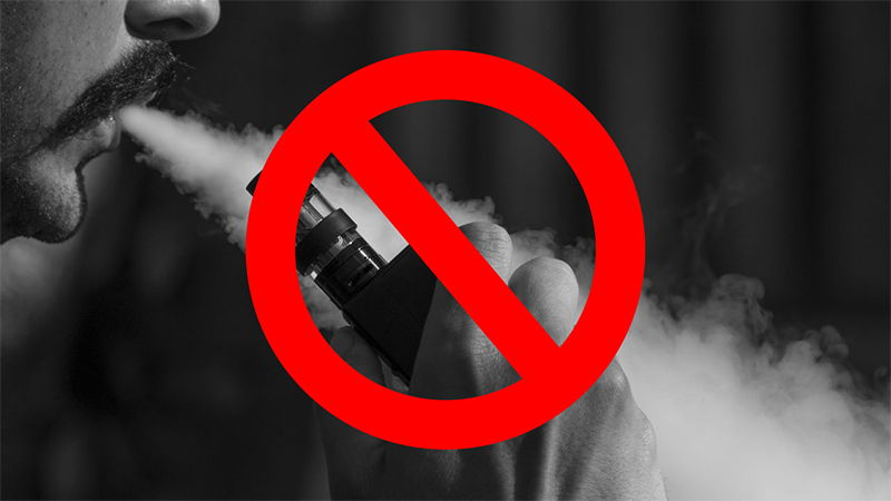E-LIQUID BANNED IN USA BLOKE VAPING WITH CROSS