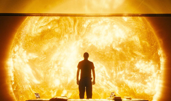 A Scene from the Sunshine 2007 Film Showing Cillian Murphy's Character Looking into Space at the Sun