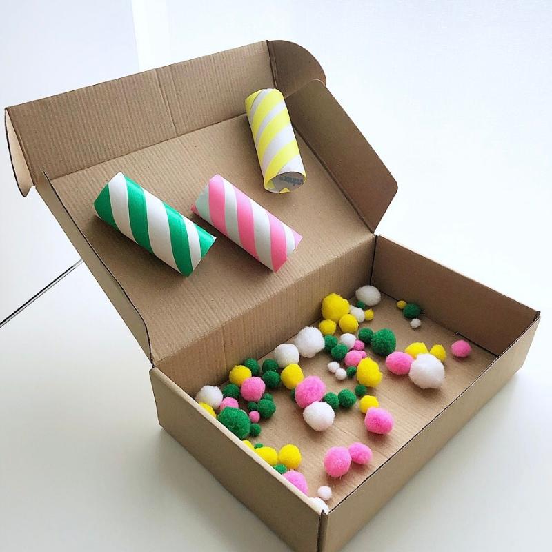 A finished pom-pom sorter box ready for play
