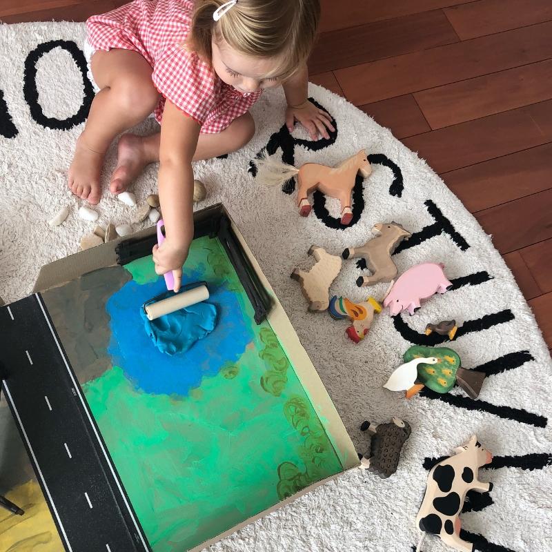 Adding a playdough lake to the farmyard playbox