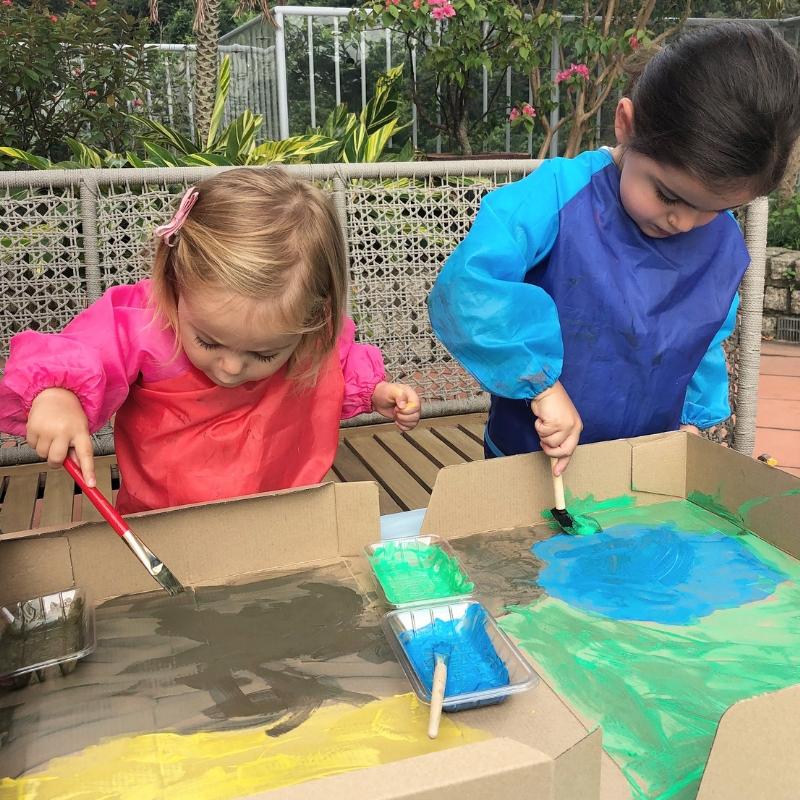 Painting the farmyard playbox