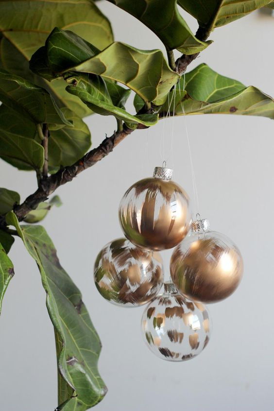 Try hanging Christmas ornaments on a potted tree to avoid buying a disposable Christmas tree this year