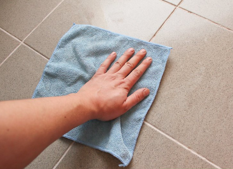 A clean towel used on surface to help render it dry.