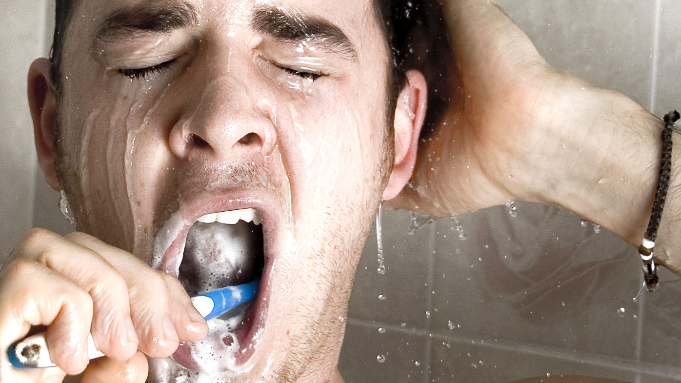 Man brushing in shower