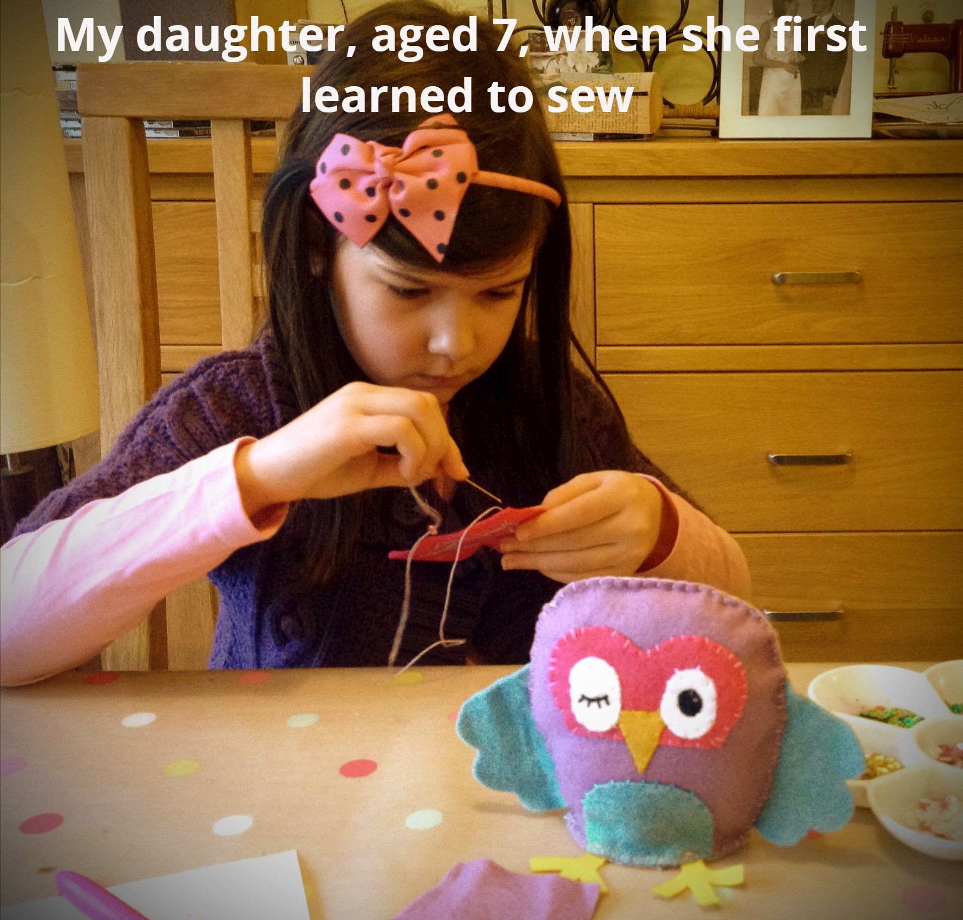 Young girl sewing a felt owl