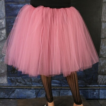 Legs wearing adult bright pink tutu.