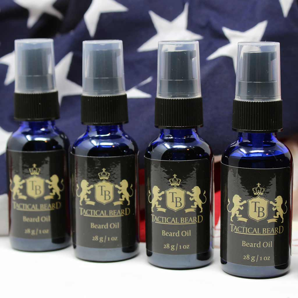 A row of tactical Beard Oils sitting in front of an American flag.