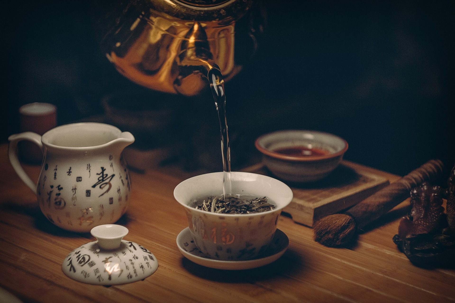 Hot water pouring in chinese gonfu tea cup