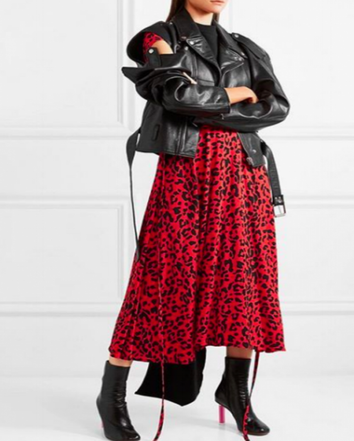 female model wearing black leather jacket with cut sleeves and red leopard print skirt by Vetements