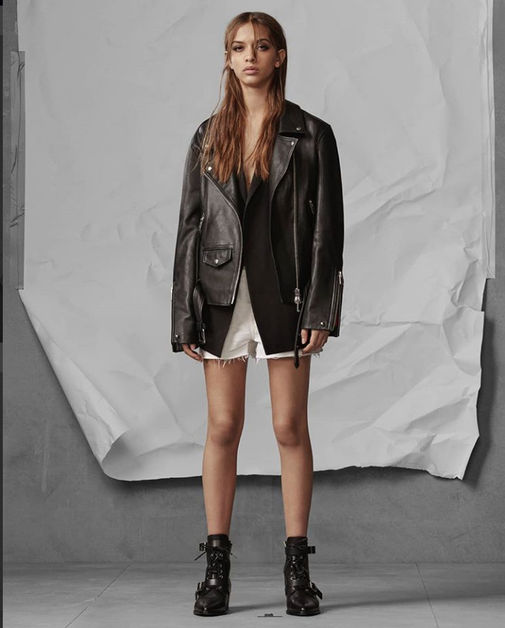 female model wearing black  leather jacket by all saints